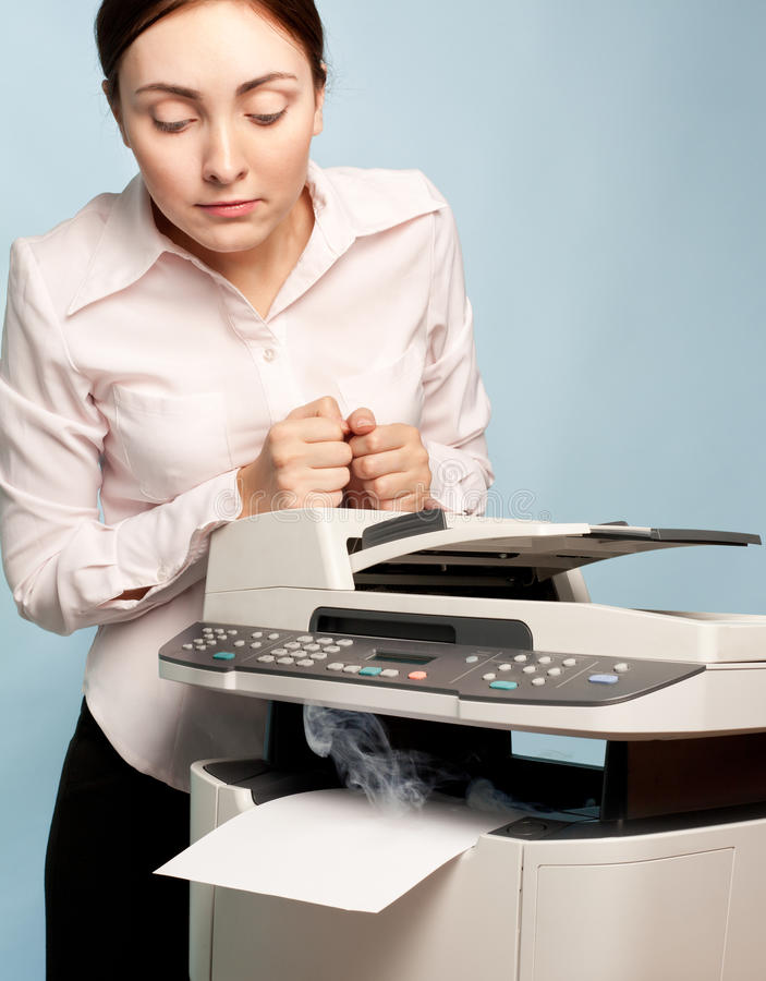 Download Surprised Woman With Smoking Copier Royalty Free Stock Images - Image: 23281739
