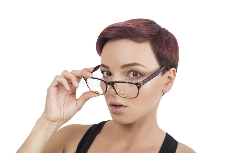 Surprised woman taking off glasses, isolated royalty free stock images