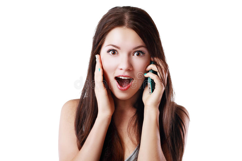 Surprised woman talk on phone. Young happy beautiful woman talking into her cell phone in gesture and surpised stock photo