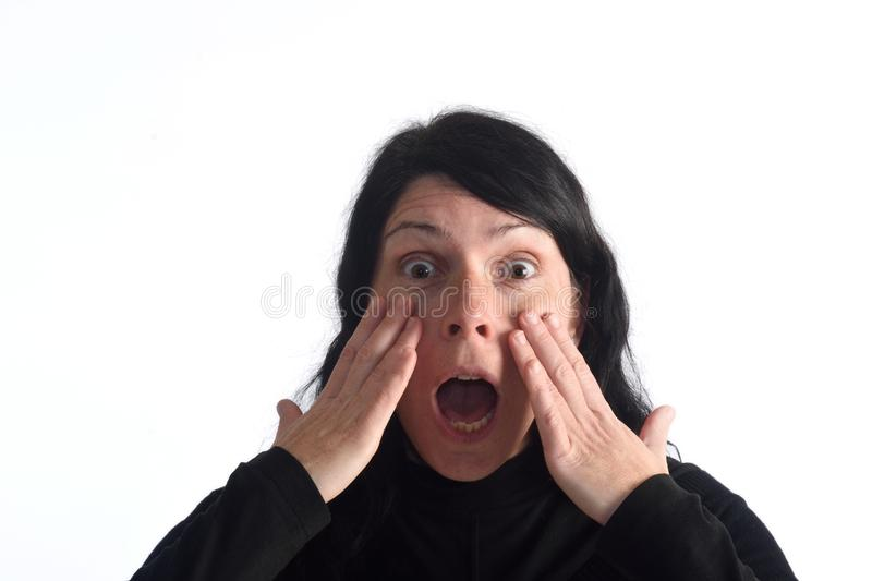 Surprised woman. On white backdround royalty free stock photography