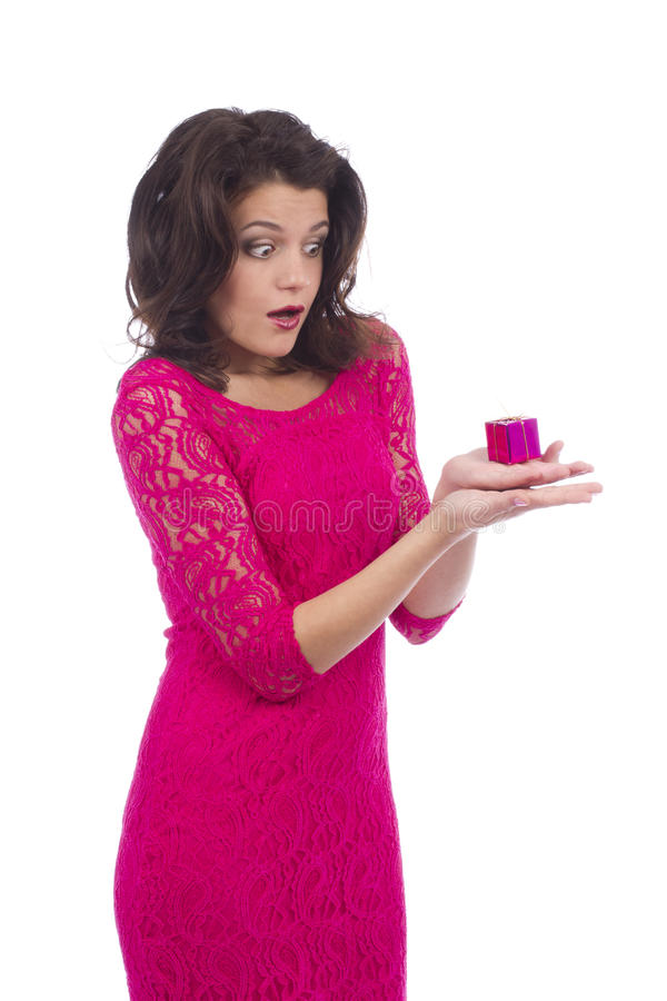 Surprised young attractive woman holding small gift royalty free stock images
