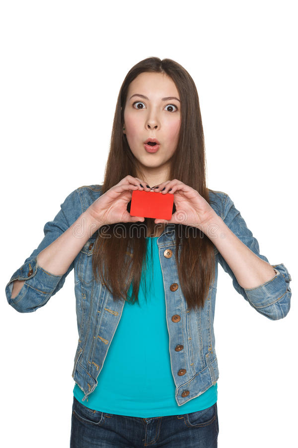 Surprised young female showing blank credit card royalty free stock photo