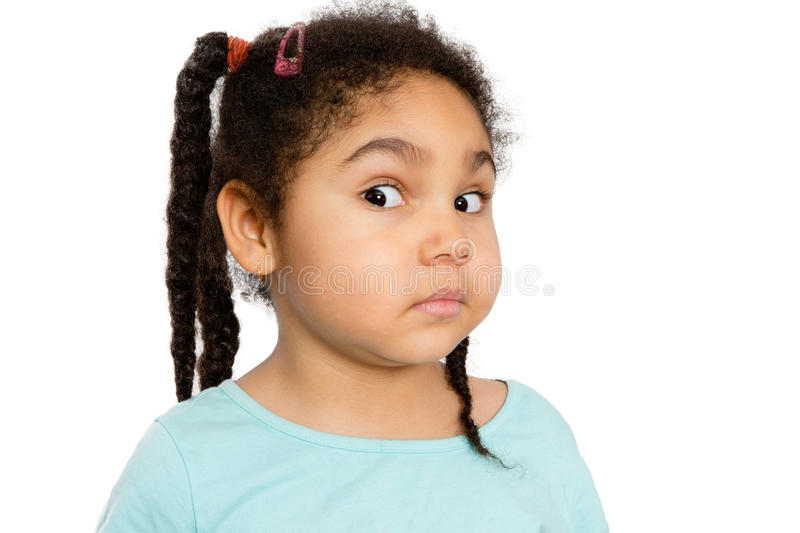 Surprised Young Girl Against White Background. Close up Cute Young Girl Showing Surprised Facial Expression Against White Background stock photo