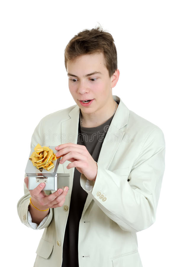 Surprised young man opening gift box. Over the white background stock photos