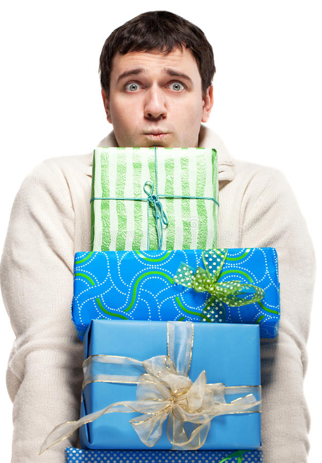 Download Surprised Young Man With Presents Stock Photo - Image of festive, green: 26832232