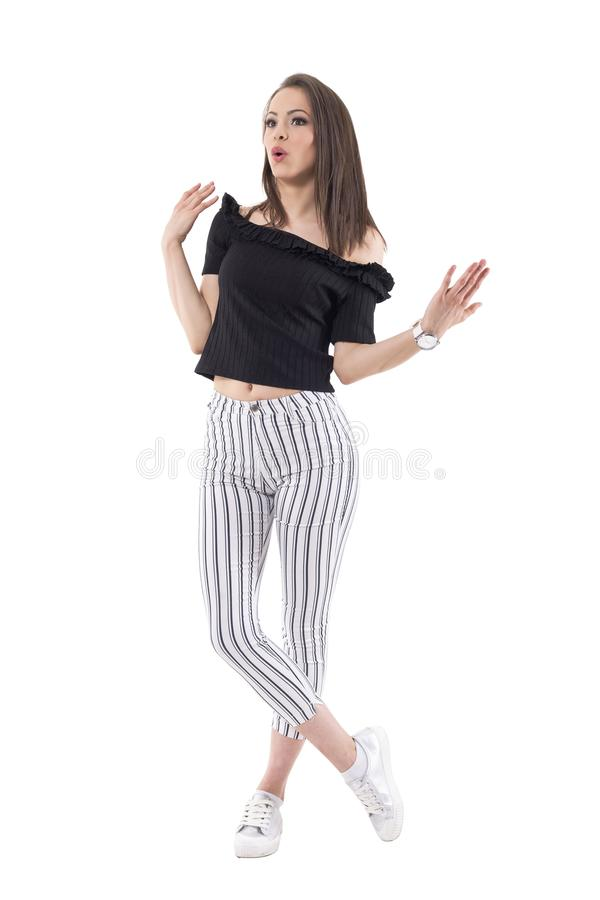 Surprised young stylish modern woman with open arms looking away royalty free stock photos