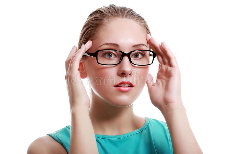 Surprised young woman. Beautiful surprised young woman in glasses.White background stock photo