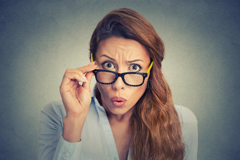 Surprised young woman. Surprised frustrated angry young woman stock image
