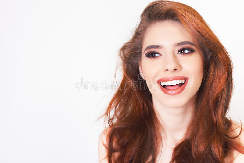 Surprised young woman with healthy perfect hair and white smile royalty free stock photos
