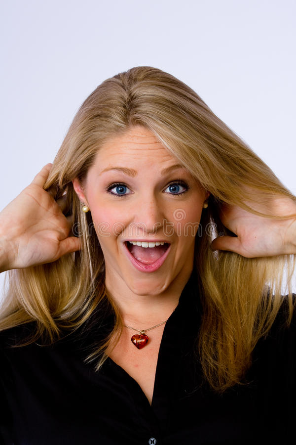 Download Surprised Young Woman Looks At Camera. Stock Image - Image: 14858563