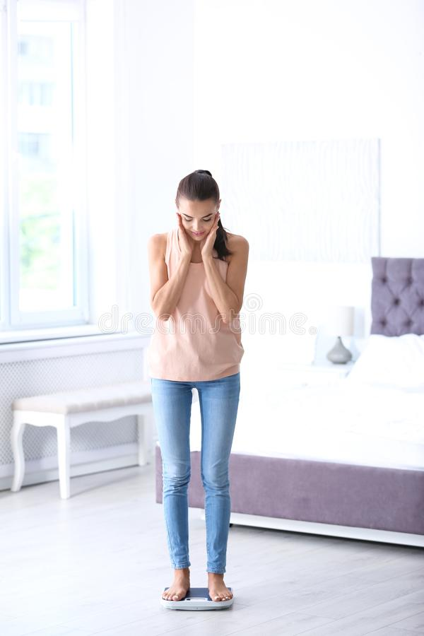 Surprised Young Woman On Scale Stock Photo
