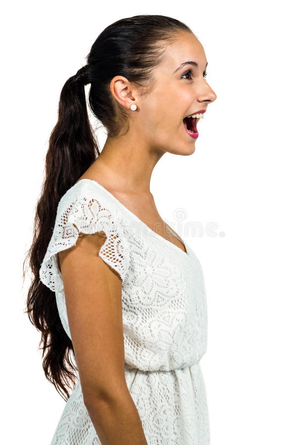 Surprised young woman with open mouth looking up stock image