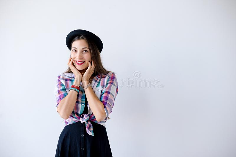 Surprised young woman touching her face and smile stock photos