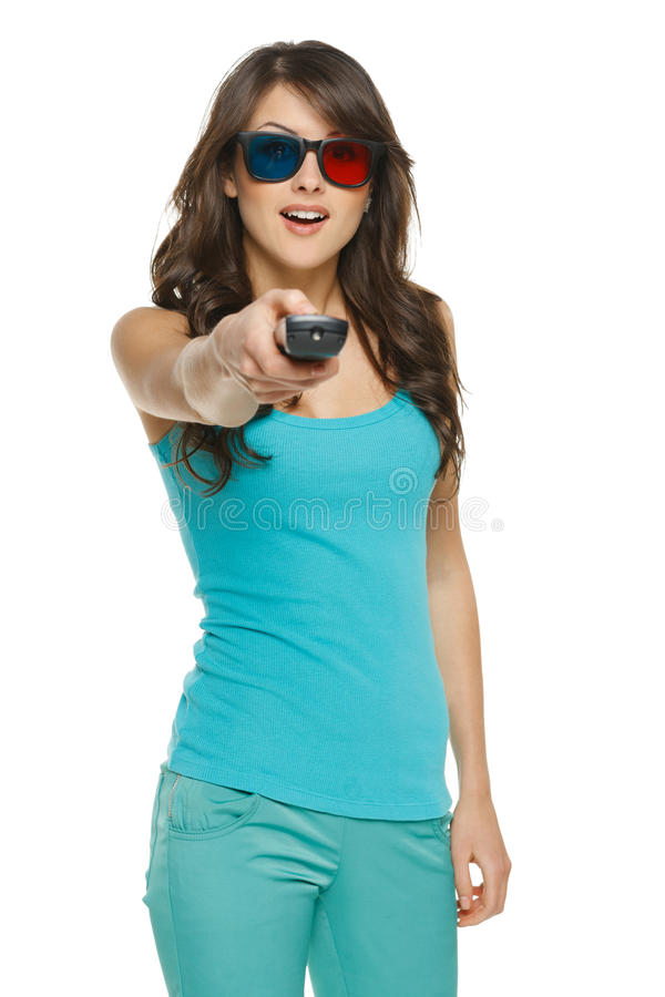 Surprised young woman with TV remote stock image