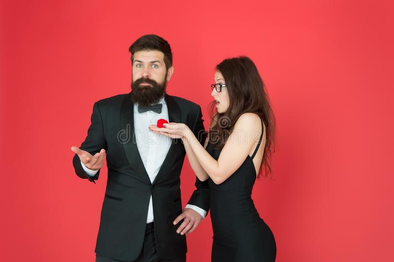 Surprising valentines gift. Sexy girl give engagement gift ring to bearded man. Couple in love. Gift surprise. Love gift stock images