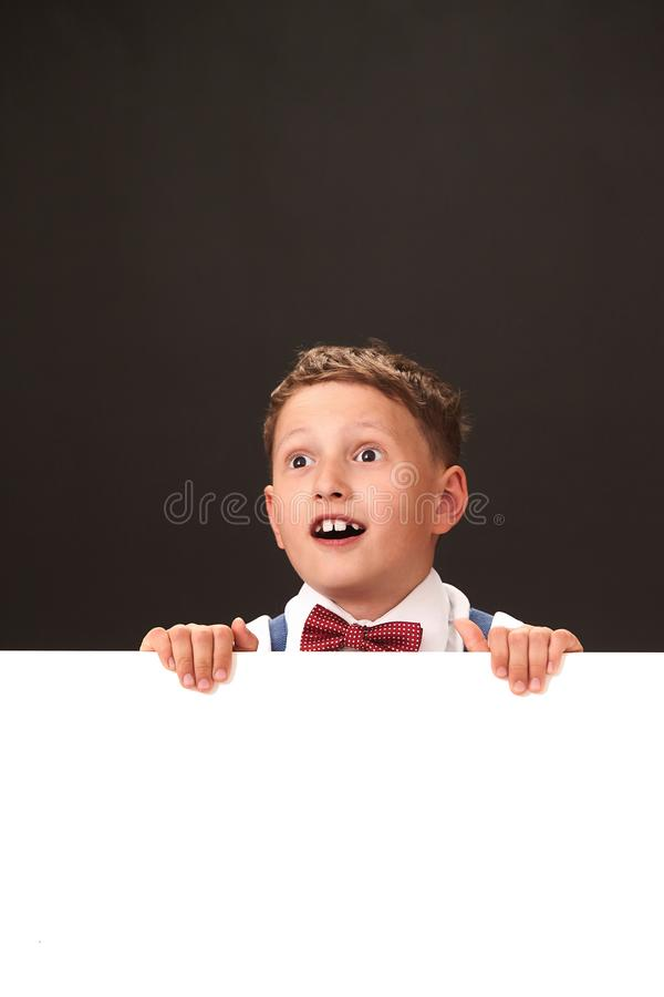Surprisingly happy child with huge eyes royalty free stock photography