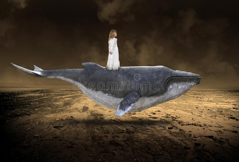 Flying Whale, Peace, Nature, Spirtual Rebirth, Love. Surreal abstract concept for love, peace, hope, nature, and spiritual rebirth. A young girl stands and rides royalty free stock image