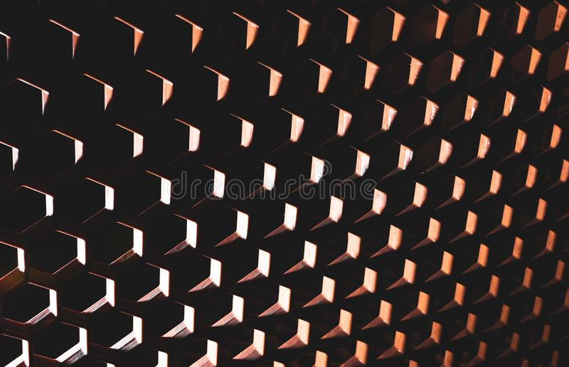 Surreal abstract honeycomb pattern with heavy shadows. Bright highlights royalty free stock photos