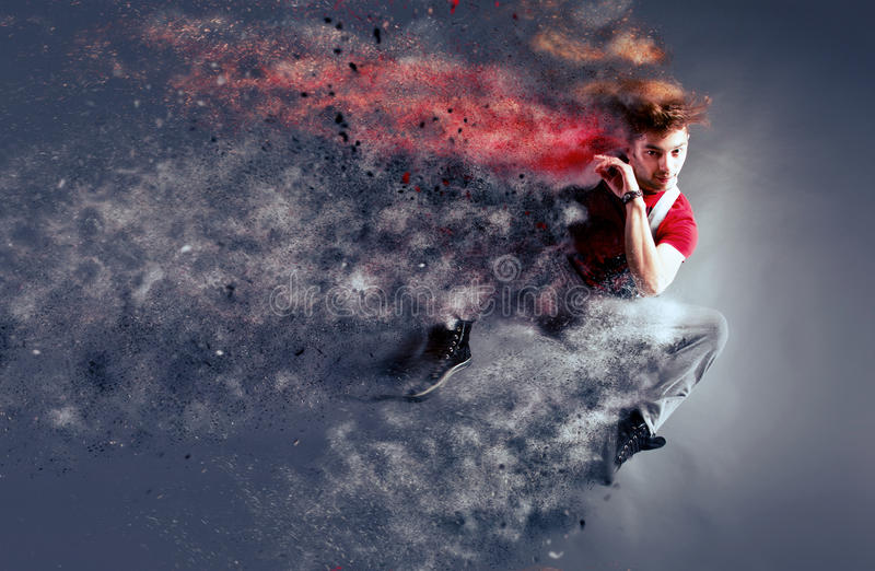 Surreal dancer decomposing in particles royalty free stock photo