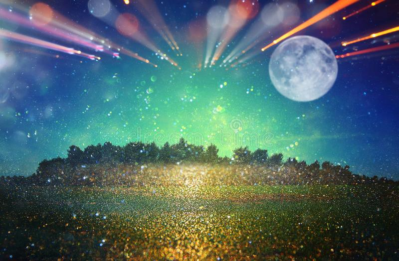 Surreal fantasy concept - full moon with stars glitter in night. Skies background stock image