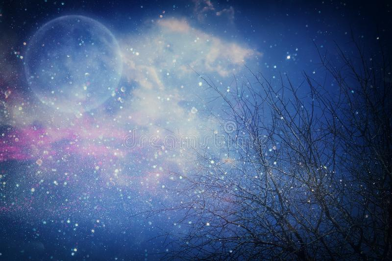Surreal fantasy concept - full moon with stars glitter in night skies background. royalty free stock photos