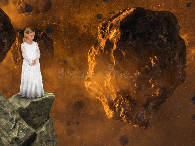 Surreal Fantasy, Imagination, Peace, Nature, Love. A young girl uses her imagination to view asteroids and space rocks in the cosmos or universe, The child is an stock image
