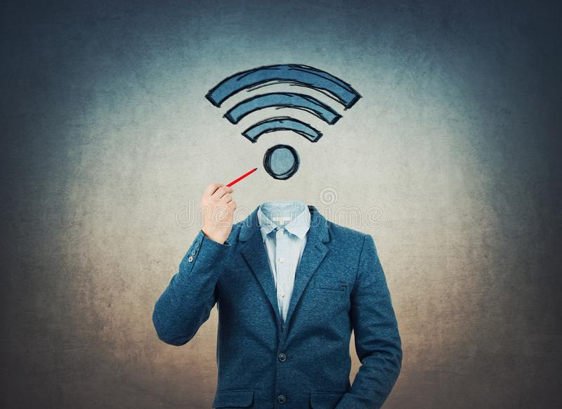 Surreal image as a businessman with invisible face holding a pencil in his hand draw WiFi symbol instead of head. Dreaming of royalty free stock image