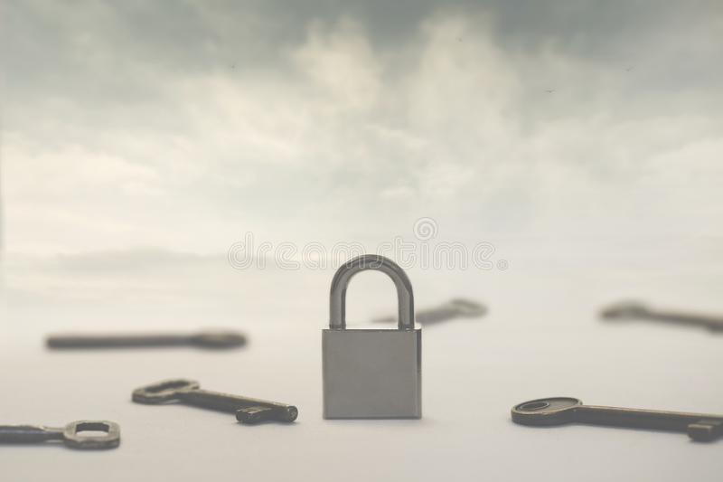 Surreal image of infinite keys as a solution to a single padlock or problem, concept of choice, success, solutions royalty free stock photos