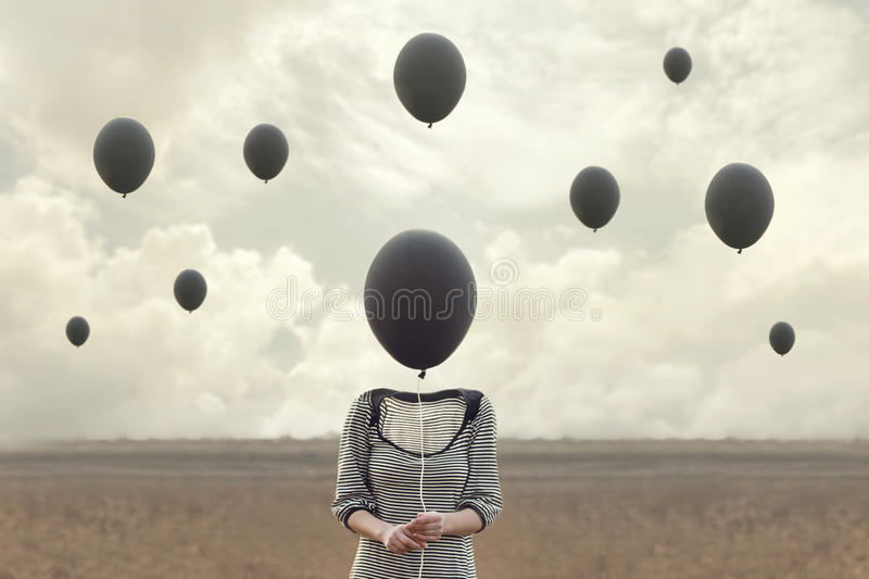 Surreal image of woman and blacks balloons flying stock photos