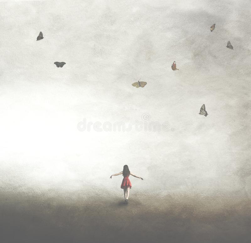 Surreal image of a woman in a red dress walking under a sky with butterflies stock images
