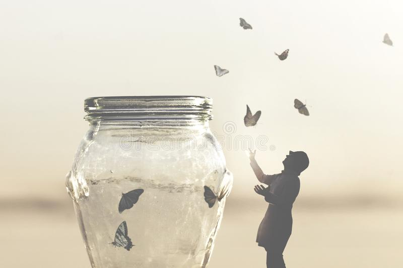 Surreal image of a woman who gives freedom to butterflies captive in a vase stock photos
