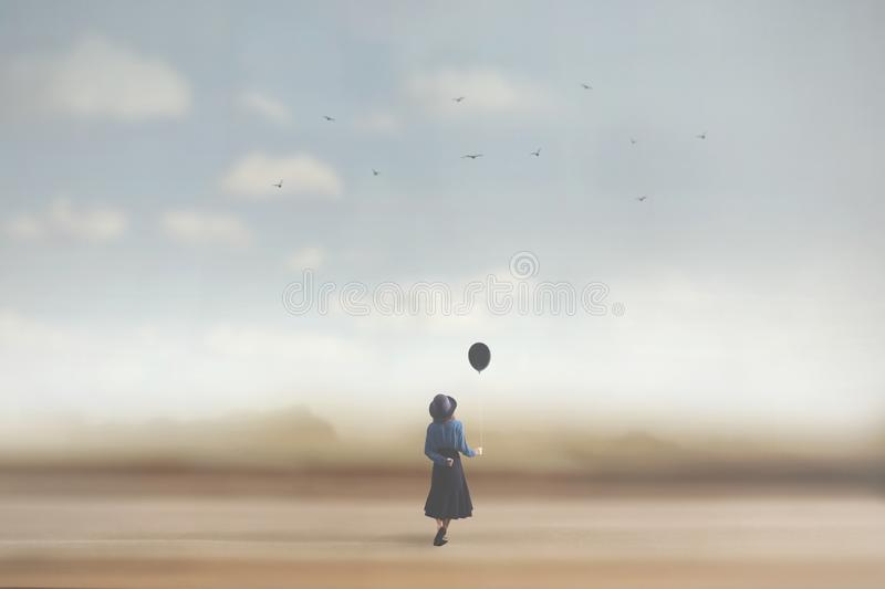 Surreal image of a young woman dreaming with a balloon royalty free stock photo