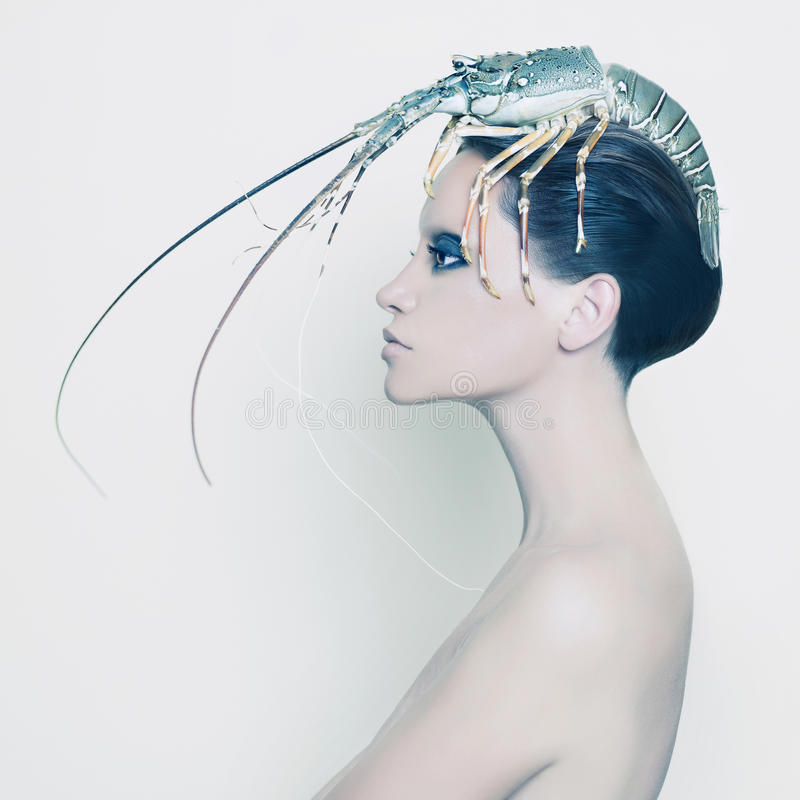 Surreal lady with lobster on her head royalty free stock photos