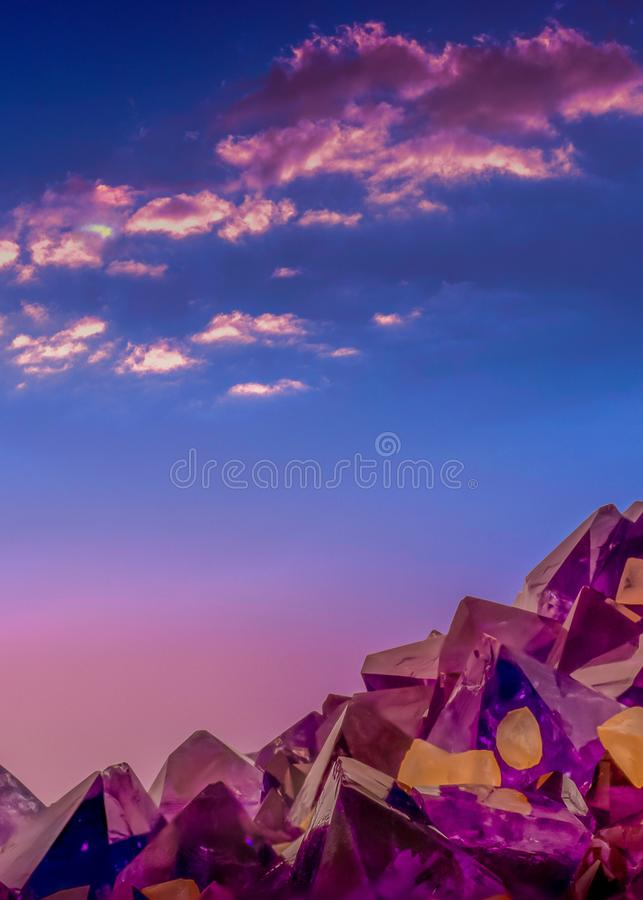 Surreal macro photo of amethyst crystals and evening sky stock image