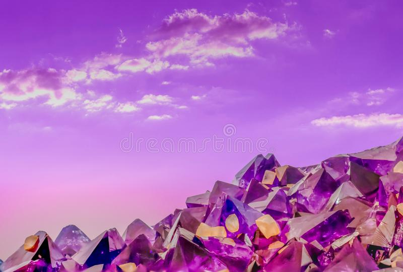 Surreal macro photo of amethyst crystals and sky stock photography