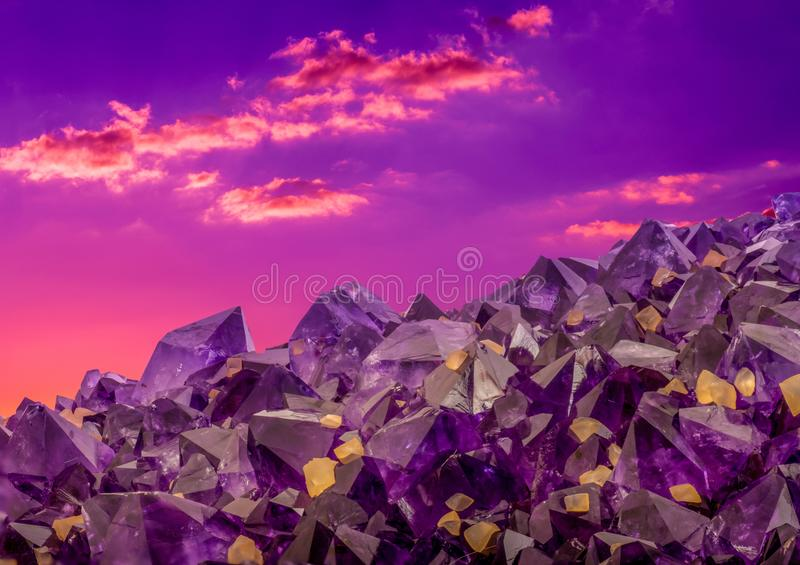 Surreal macro photo of amethyst crystals and sunset sky royalty free stock photos