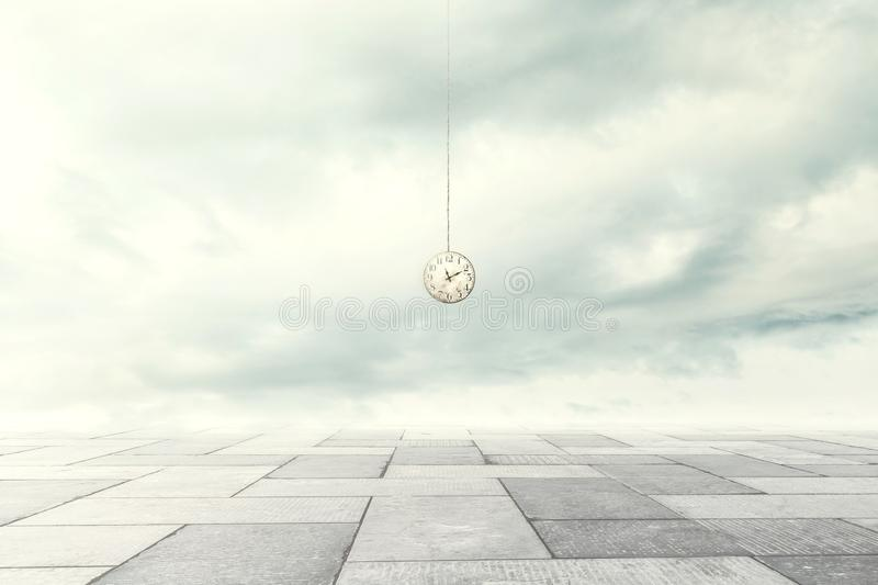 Surreal moment of a clock coming down from the sky. In a urban place stock photos