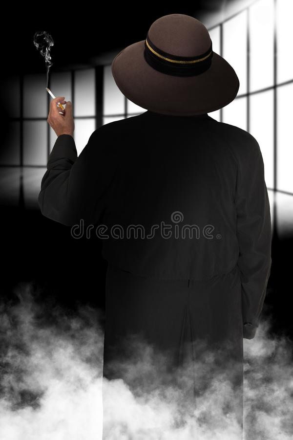 Surreal Mysterious Woman Smoking Cigarette. Surreal mysterious woman smoking a cigarette. Fog adds to the look and feel like a spy novel royalty free stock images
