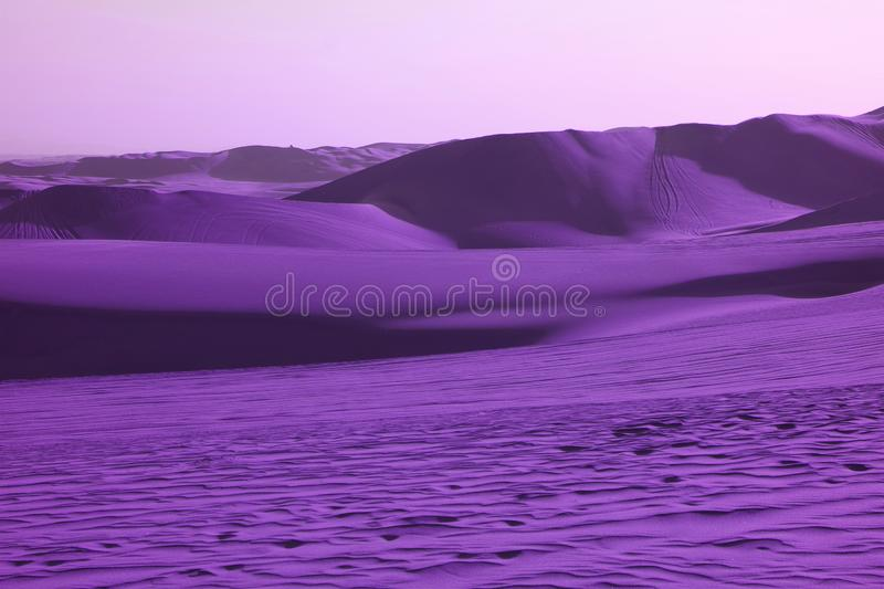 Surreal pop art styled vibrant purple colored desert with fantastic sand ripples and sand dunes royalty free stock photos