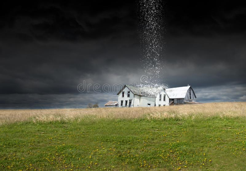 Surreal Rain Storm, Weather, Farm, Barn, Farmhouse. Surreal landscape of a farmhouse and barn on the farm. A freak weather rain storm is raining down on the royalty free stock photography
