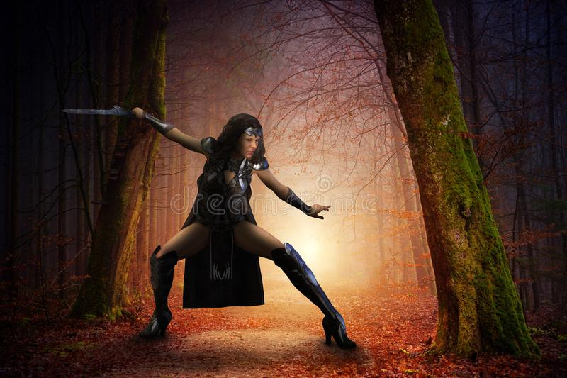 Fantasy Warrior Goddess Woman, Battle. Surreal warrior goddess woman. The fantasy scene has a female soldier ready for battle in ancient times. The girl is in a stock photos