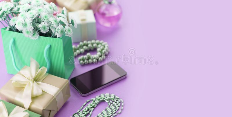 Surrealism Banner Decorative composition boxes with gifts flowers women& x27;s jewelry shopping holiday blue background. stock image