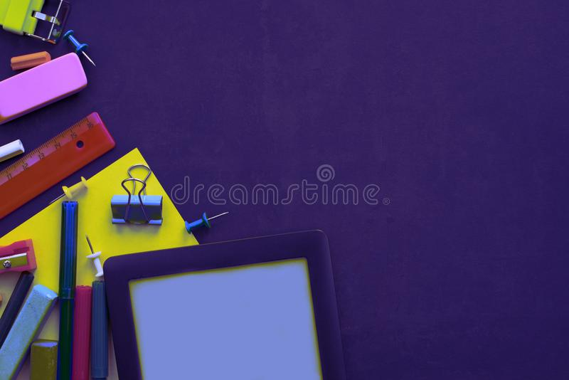 Surrealism Concept back to school apple backpack stationery on black background. Top view Flat lay stock images