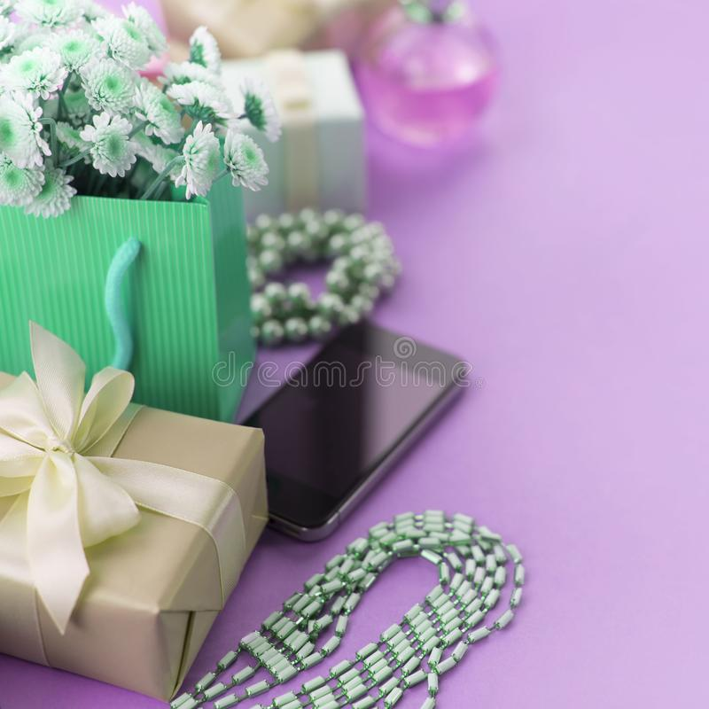 Surrealism Decorative composition boxes with gifts flowers women's jewelry shopping holiday blue background. stock photo
