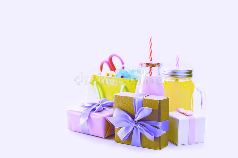 Surrealism Decorative composition festive exotic cocktail on white background box with confetti gift satin ribbon. royalty free stock photos