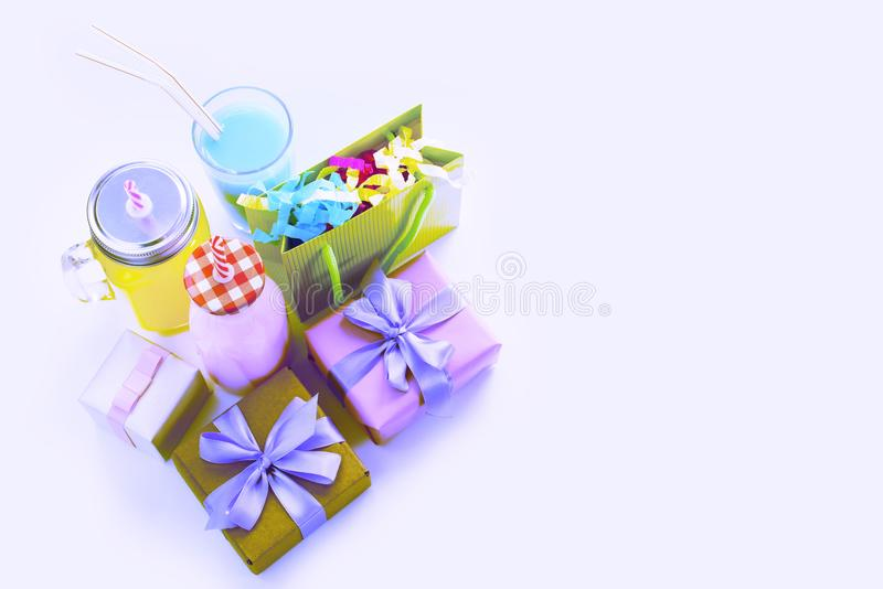 Surrealism Decorative composition festive exotic cocktail on white background box with confetti gift satin ribbon. stock photography
