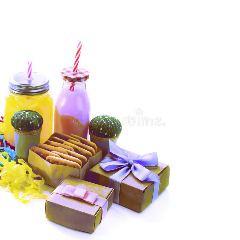 Surrealism Decorative composition festive exotic cocktail on white background box with confetti gift satin ribbon. stock image