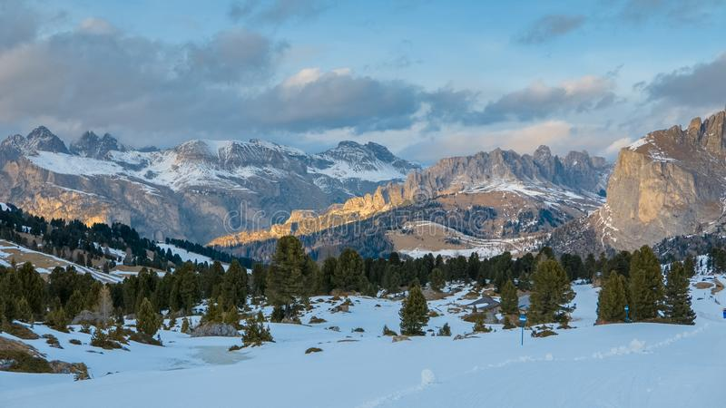 Surrealistic winter panorama of Alpine valley in early spring royalty free stock photo