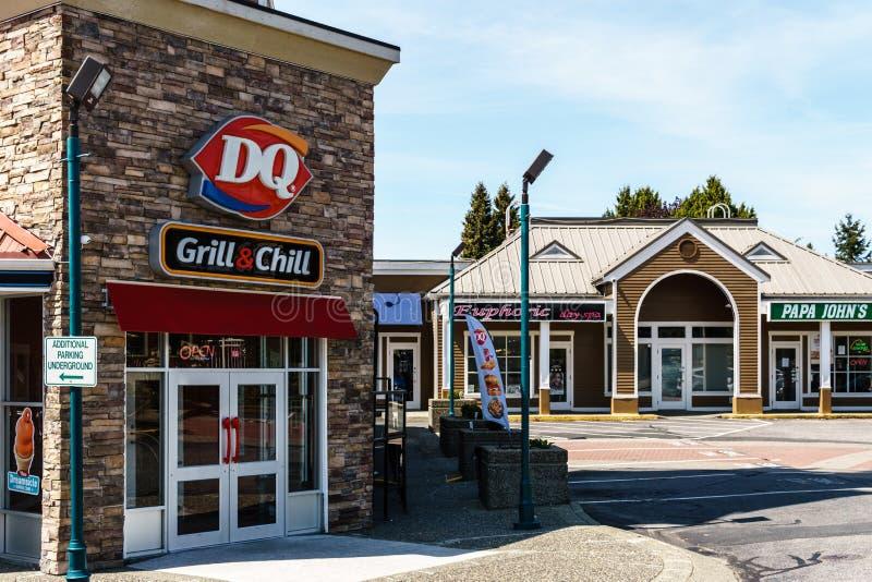SURREY, CANADA - May 5, 2019: Sunshine Village Strip mall or shopping plaza sunny spring day royalty free stock photo