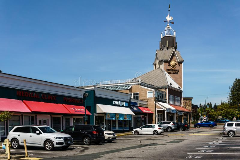 SURREY, CANADA - May 5, 2019: Sunshine Village Strip mall or shopping plaza sunny spring day. America, parking, sky, architecture, building, center, commercial royalty free stock images